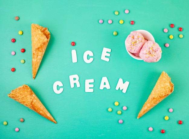 Strawberry ice cream  scoops in white bowl with topping on aquamarine background Premium Photo