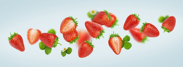 Strawberry isolated on gray background, falling strawberries Premium Photo