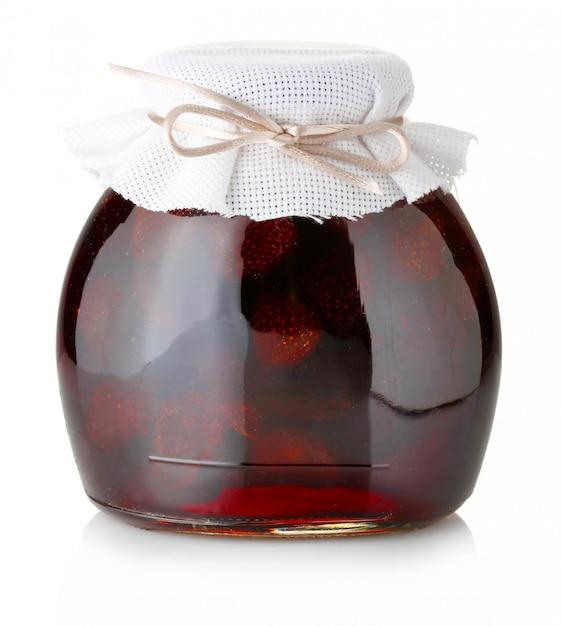 Strawberry jam with ripe strawberries isolated on white Premium Photo