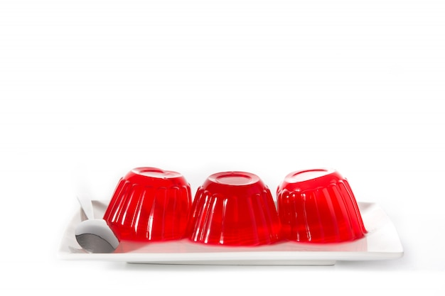 Strawberry jellies on a plate isolated on white background Premium Photo