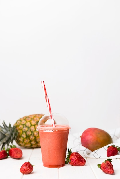 Strawberry smoothie in cup Premium Photo