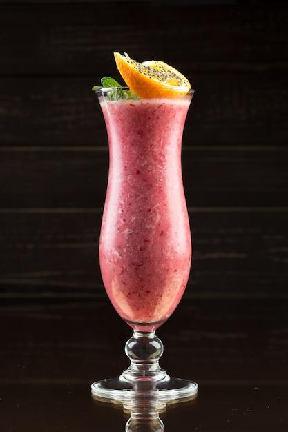 Strawberry smoothie on dark Premium Photo
