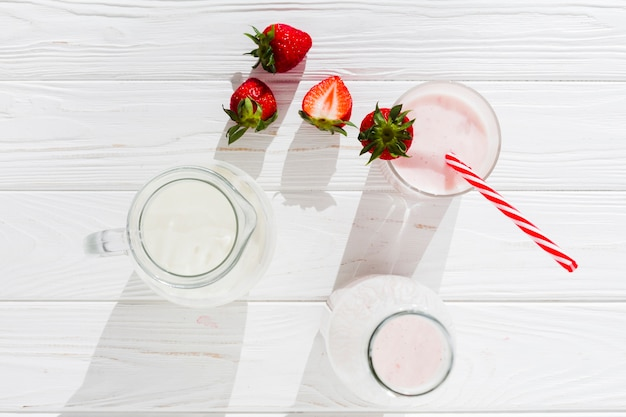 Strawberry smoothie and milk in jug Free Photo