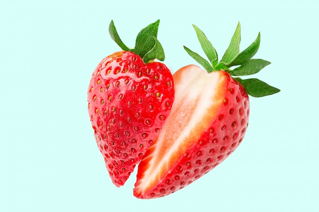 Strawberry. strawberry slices flying in the air. fresh  strawberry Premium Photo