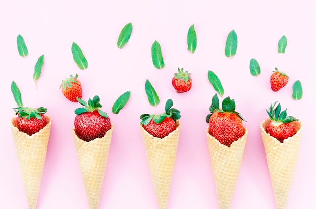 Strawberry in waffle cones for ice cream on light background Free Photo