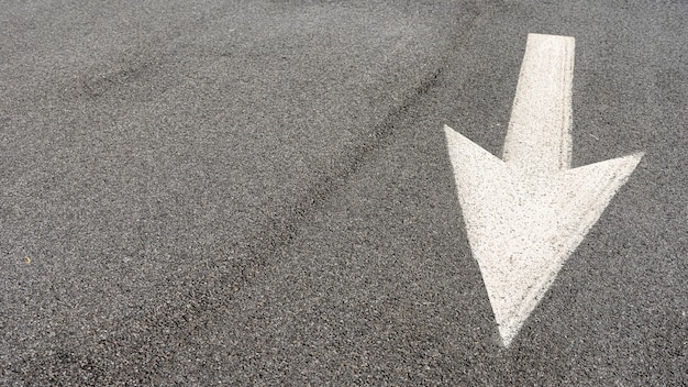 Street arrow signage with copy space Free Photo
