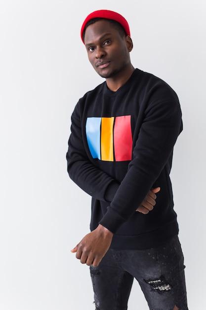 Street fashion concept - studio shot of young handsome african man wearing sweatshirt against white Premium Photo