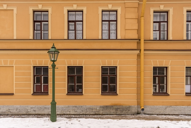 Street lamp in the old style of the old house winter time Premium Photo