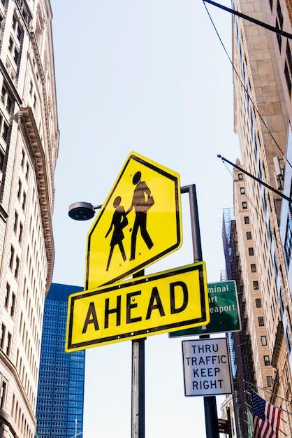 Street sign ahead on pillar Free Photo