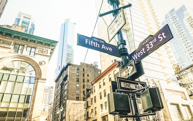 Street sign of fifth ave and west 33rd st in new york city Premium Photo