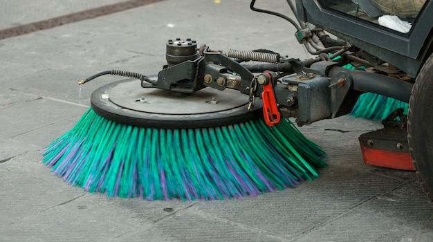Street sweeper machine cleaning the streets Premium Photo