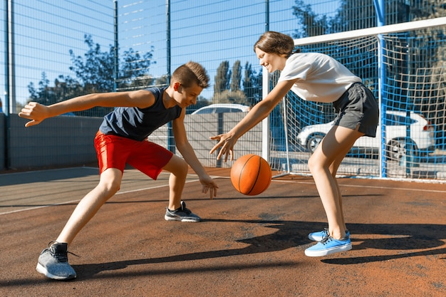 Streetball basketball game with two players Premium Photo