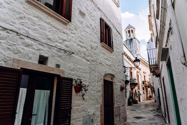 Streets with houses with whitewashed walls of the typical italian city of locorotondo. Premium Photo