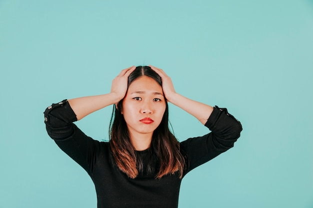 Stressed Asian woman Free Photo