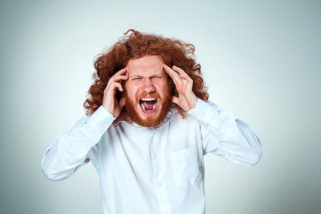 Stressed businessman with a headache Free Photo