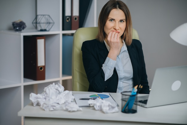 Stressed businesswoman annoyed using stuck laptop, angry woman mad about computer problem frustrated with data loss, online mistake, software error or system failure. Premium Photo