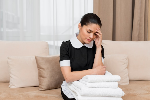 Stressed chambermaid in hotel room Free Photo
