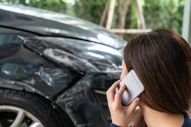 Stressed driver sitting at roadside after traffic accident Premium Photo