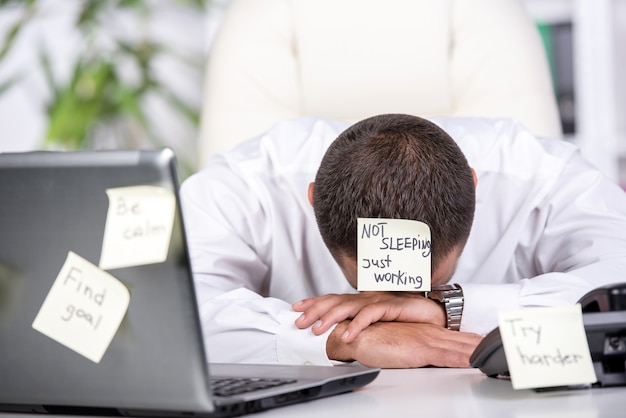 Stressed man is looking online for a job. Premium Photo