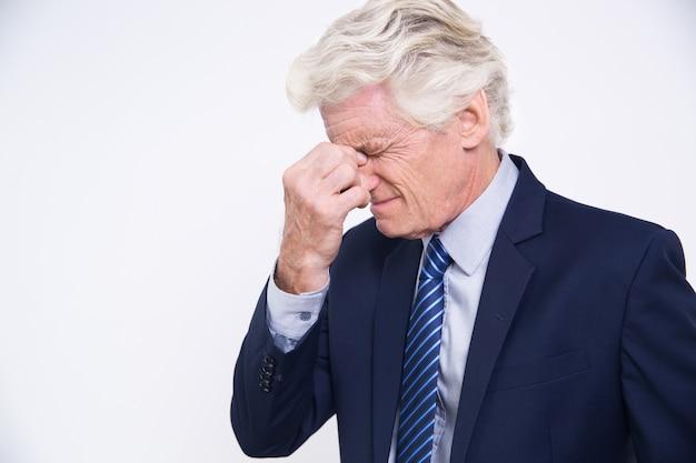 Stressed senior Caucasian businessman rubbing eyes Free Photo