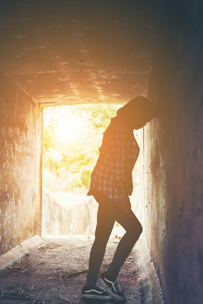 Stressed teenager with her head against the wall Free Photo