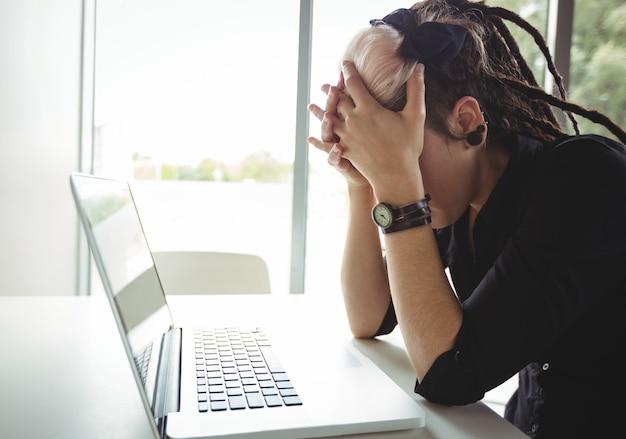 Stressed woman using laptop Free Photo