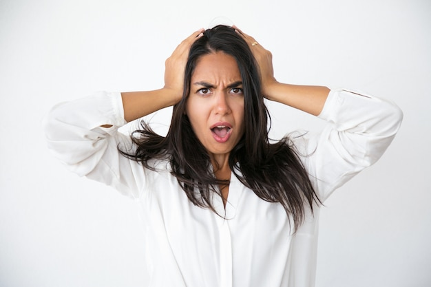 Stressed worried woman shocked with unexpected news Free Photo