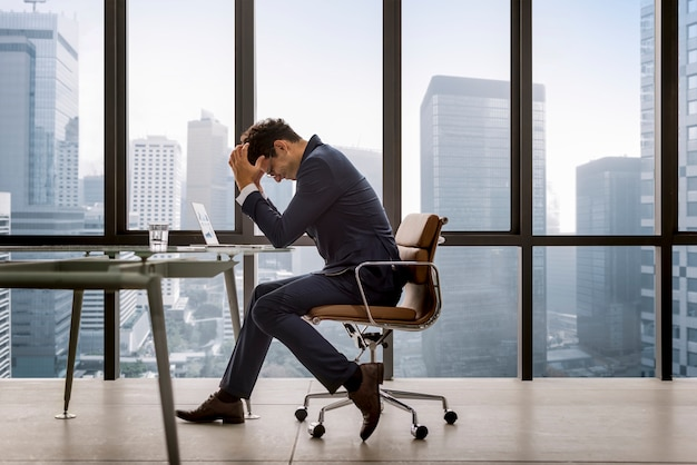 Stressed young businessman overworking Premium Photo