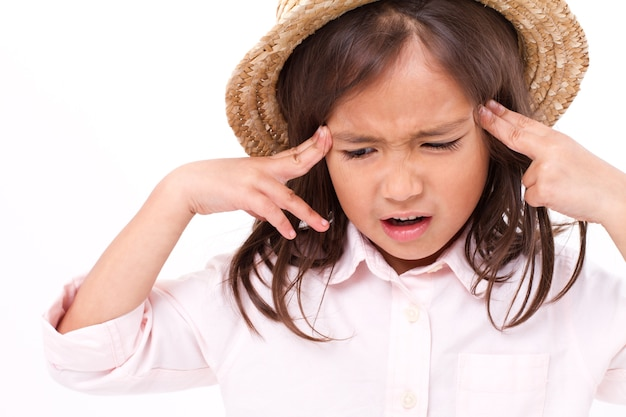 Stressful, sick little girl suffering from headache Premium Photo