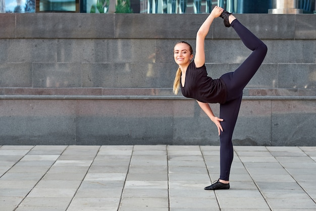 Stretching fit or dancer or fitness woman doing exercise Premium Photo