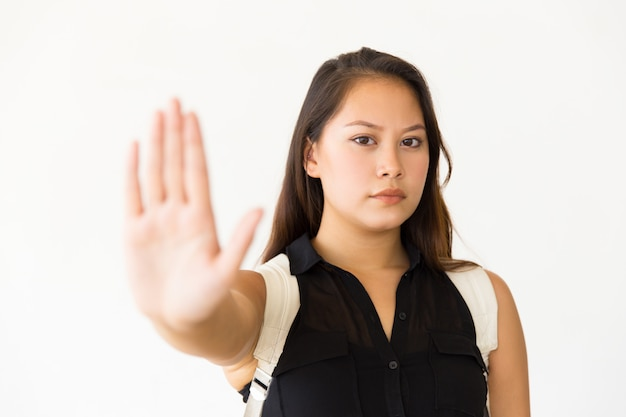 Strict serious teenage girl making stop hand gesture Free Photo