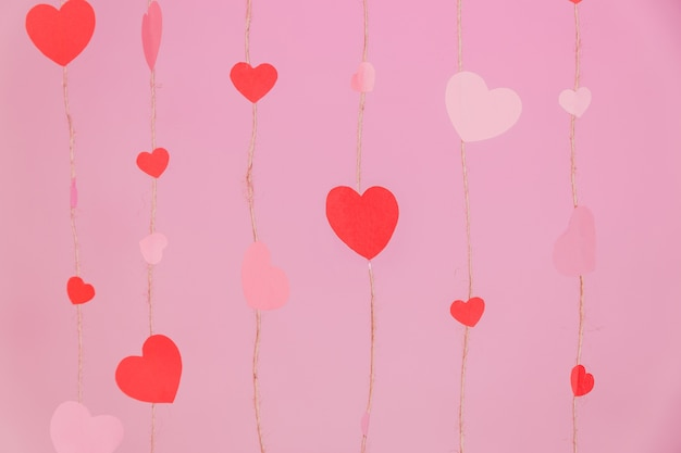 Strings composed of hearts on a pink background Free Photo