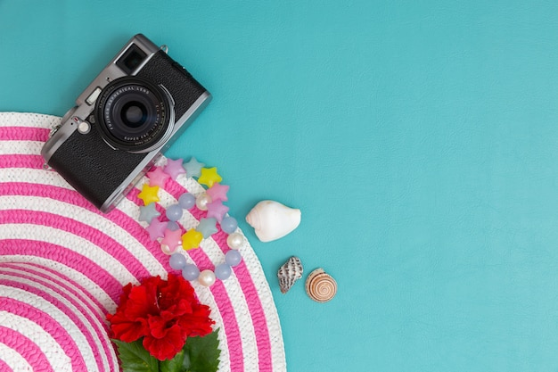 Striped retro hat with vintage camera and accessory for summer. Premium Photo