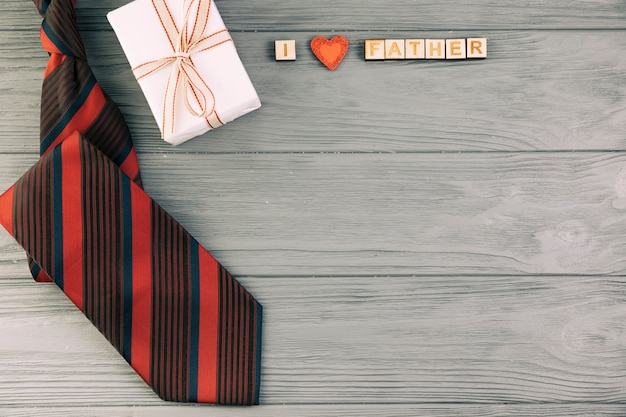 Striped tie near gift and i love father title Free Photo