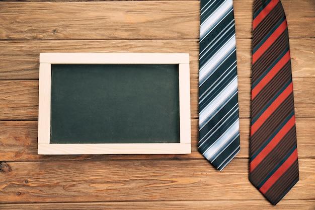 Striped ties on board near blackboard Free Photo
