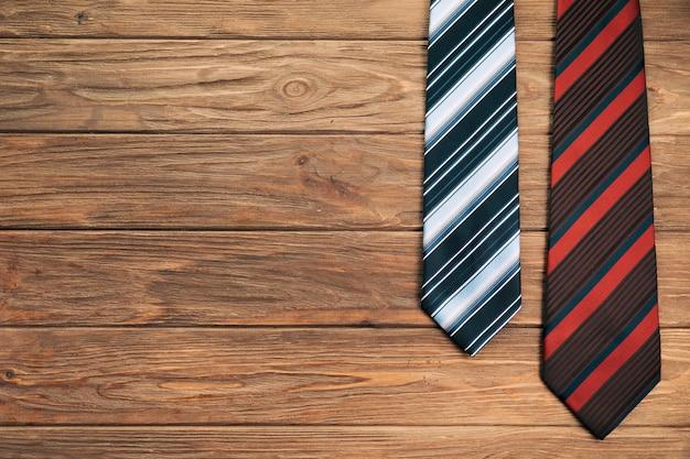 Striped ties on board Free Photo