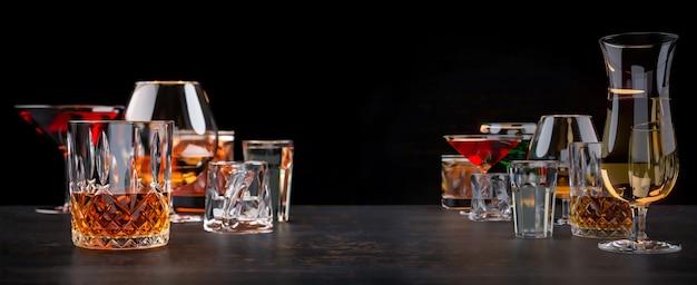 Strong alcoholic drinks on dark background Premium Photo