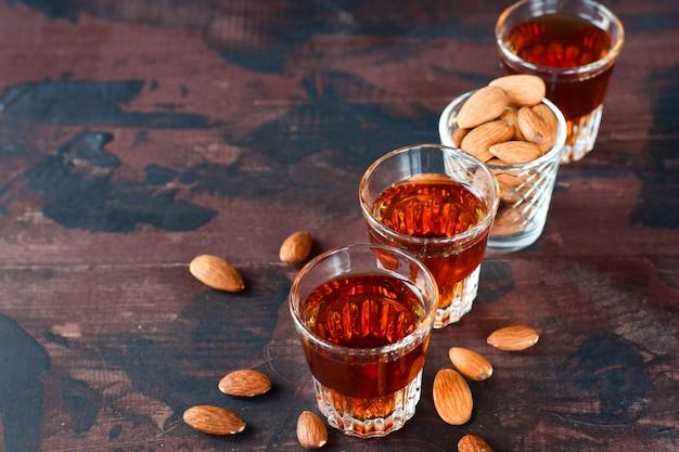 Strong alcoholic italian liqueur amaretto with almonds nuts Premium Photo