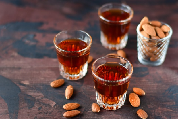 Strong alcoholic italian liqueur amaretto with almonds nuts Premium Photo