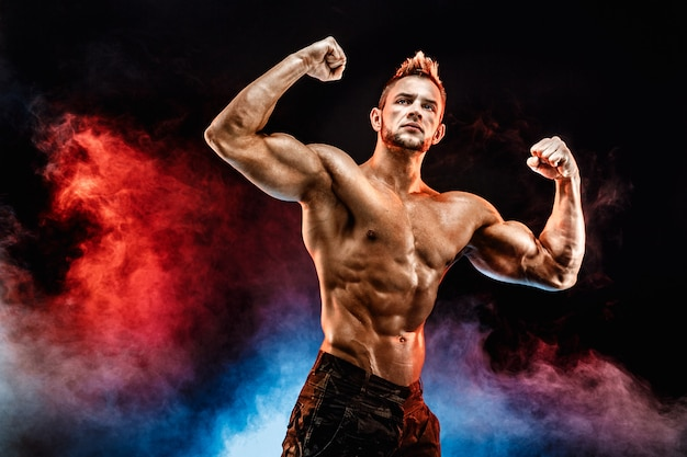 Strong bodybuilder man in military pants with perfect abs, shoulders, biceps, triceps, chest Premium Photo