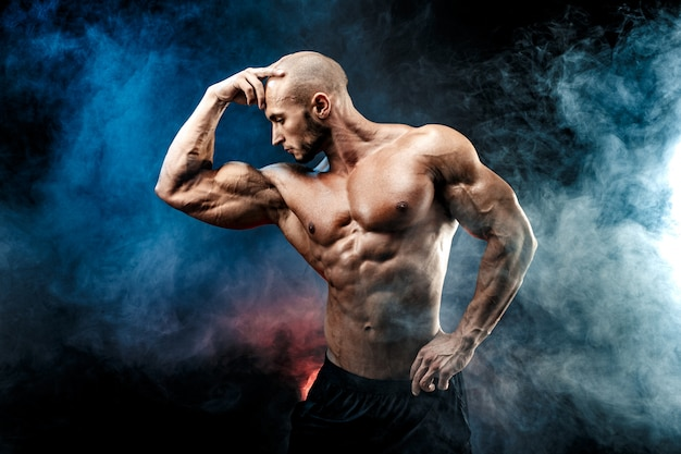 Strong bodybuilder man with perfect abs, shoulders,biceps, triceps, chest Premium Photo
