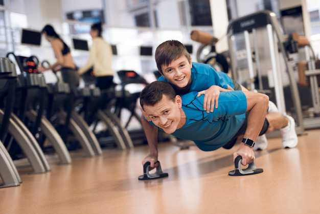 Strong dad wrung out with his son on his back. Premium Photo