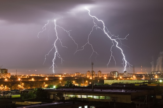 Strong lightning flash in the night sky above the city Premium Photo