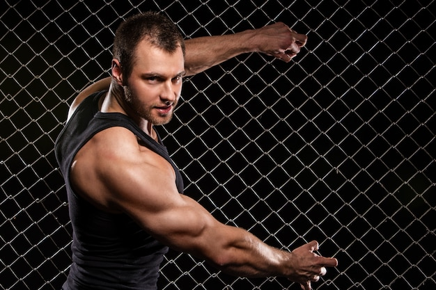 Strong man and his muscles Free Photo