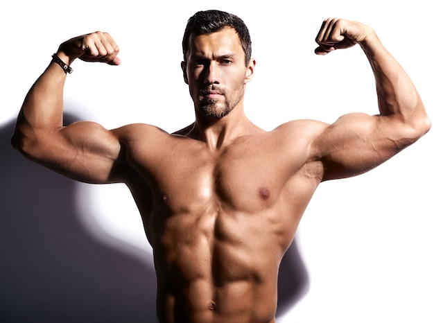 Strong man with his armas raised Free Photo