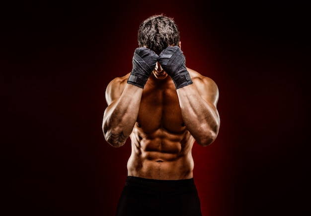 Strong muscular fighter hiding face from camera Premium Photo