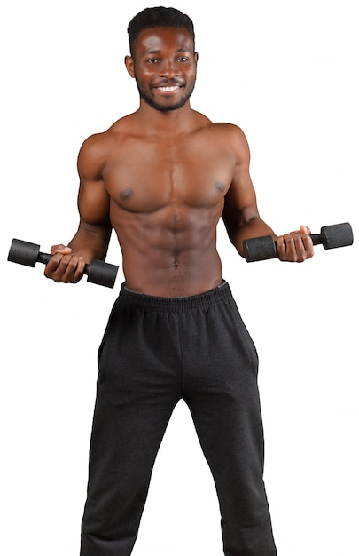 Strong and muscular guy with dumbbell isolated on white Premium Photo