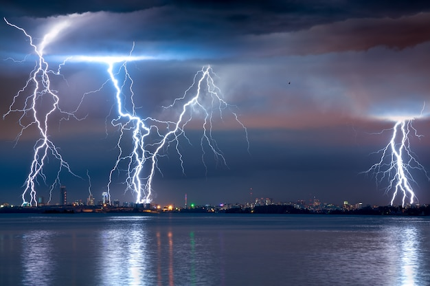 Strong thunderstorm with lightning over the city Premium Photo