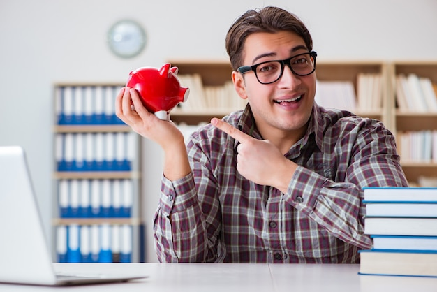 Student breaking piggybank to pay for tuition fees Premium Photo