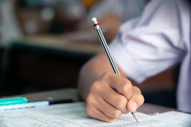Student doing test in classroom Premium Photo